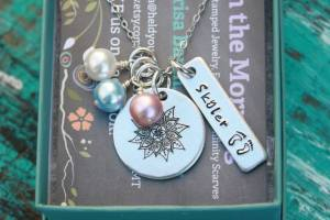 sacred keychain 1 tag in box